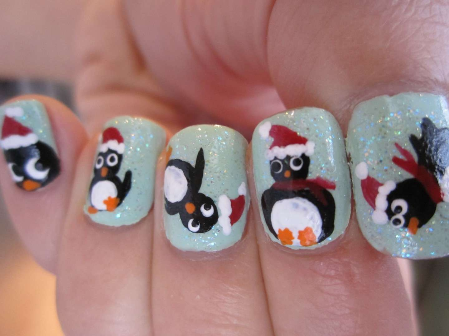 Divertente nail art con pinguino