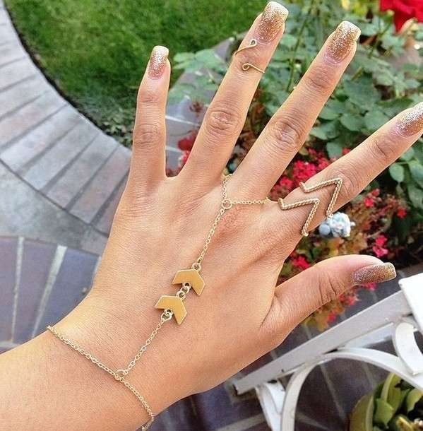Knuckle ring con catena