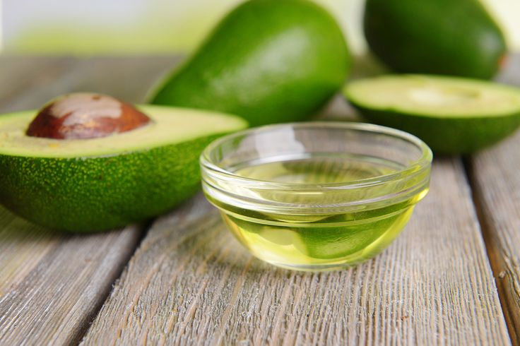 Avocado oil on table close up